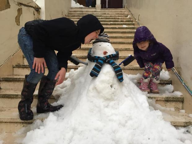 Two children in Swieqi built their own version of a snowman. Photo: Franco Portelli