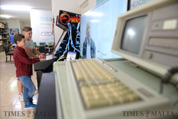 Two boys play an arcade machine at the Malta Vintage Computer Club in Attard on November 5. It was the first open weekend the club has hosted and the public was treated to a display of retro games and old machines. Photo: Matthew Mirabelli