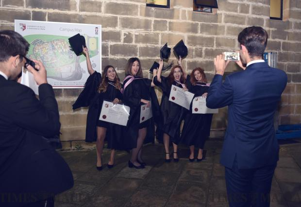 Students celebrate whilst taking a picture during a graduation ceremony at the Malta University on November 13. Photo: Mark Zammit Cordina