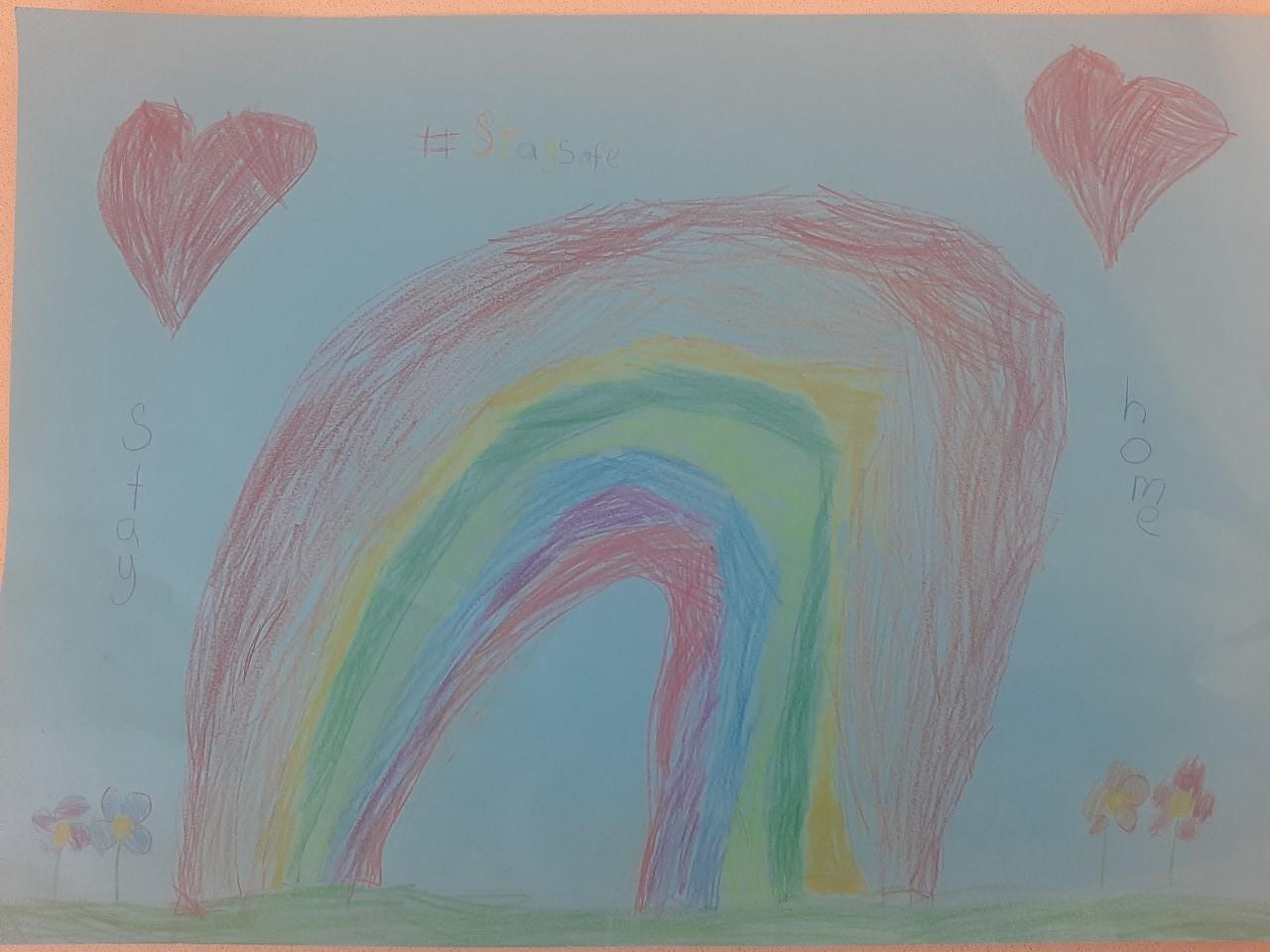 Vanessa (7) embellished her her rainbow with hearts and flowers.