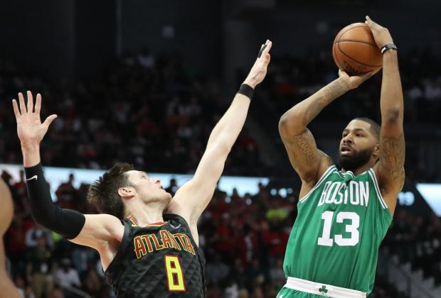 Boston Celtics forward Marcus Morris (13) shoots against Atlanta Hawks forward Luke Babbitt (8) in the third quarter at Philips Arena. Photo: Jason Getz-USA TODAY Sports