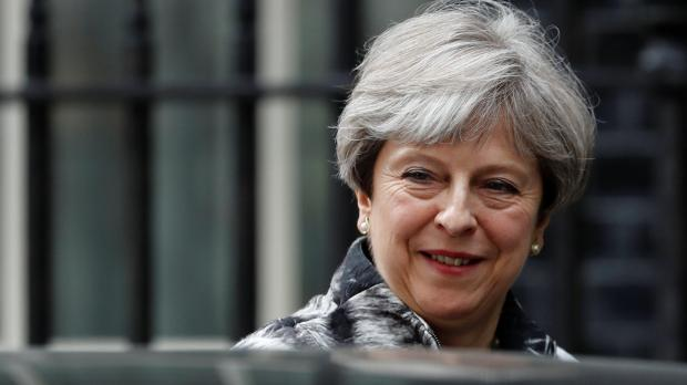 Theresa May appeared contrite, Conservative MPs at the meeting said. Photo: Reuters