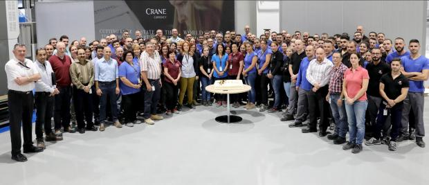 Staff at Crane Currency celebrate the achievement.