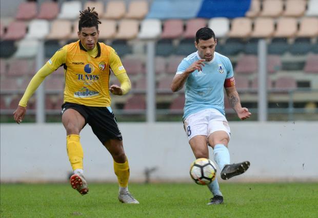 Mark Scerri (right) of Sliema Wanderers attempts a pass despite Qormi's Yannick Yankam's pressure.