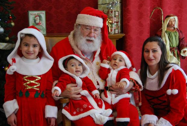 Malta's Santa Klaws, Albert McCarthy, poses for a photo with children on December 23. Mr McCarthy was voted the most authentic Santa at the World Santa Claus Congress in 2008. Photo: Mark Zammit Cordina