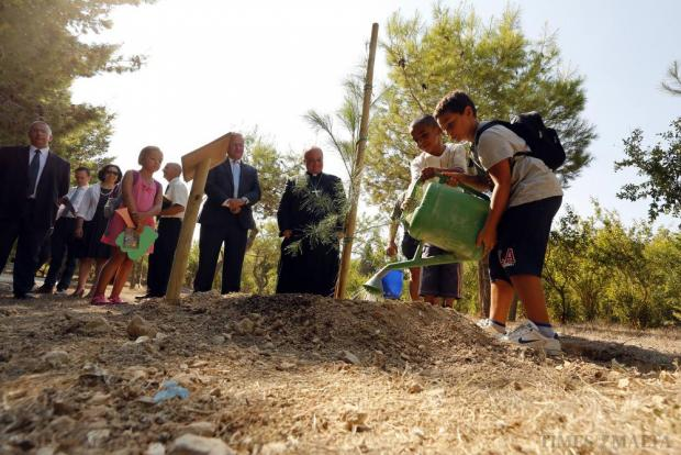 Archbishop Charles Scicluna and Environment Minister Leo Brincat, together with schoolchildren, plant a tree to mark the occasion of the first World Day of Prayer for the Care of Creation at the Ta' Qali National Park on September 1. Photo: Darrin Zammit Lupi