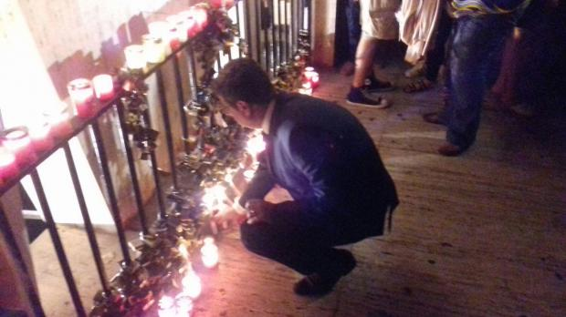PN leader Adrian Delia lights a candle at the vigil.