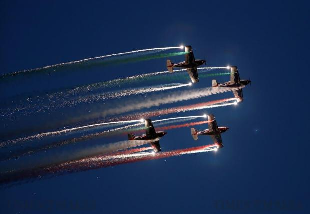 The Pioneer Team, a civil aerobatic team from Italy, let off pyrotechnics from their Pioneer 330 aircraft during the Malta International Airshow off SmartCity Malta on September 24. Photo: Darrin Zammit Lupi