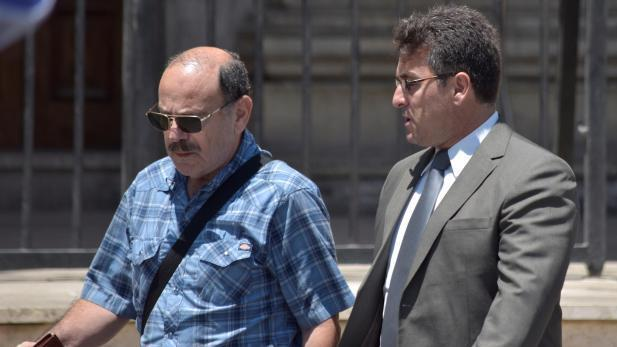 File photo. John Suda (left) seen leaving the law courts.