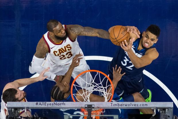 Minnesota Timberwolves center Karl-Anthony Towns (32) shoots in the third quarter against Cleveland Cavaliers forward LeBron James (23) at Target Center. Photo: Brad Rempel-USA TODAY Sports