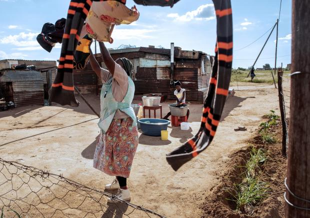 a woman gathers washing in Tlhabologang Township in Coligny, some 120kms west of Johannesburg.