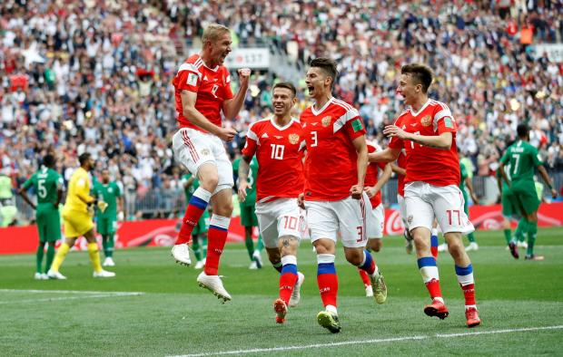 Russia's Yury Gazinsky celebrates scoring their first goal with team mates.