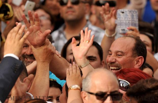 Ex Labour Party whip and Minister Godfrey Farrugia is warmly greeted by cheering crowds at the Nationalist Party mass meeting in Zebbug on May 14. Dr Farrugia is contesting the June 3 election with the Democratic Party, which is in coalition with the Nationalist Party. Photo: Chris Sant Fournier