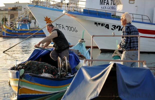 Fishermen prepare their boats for a fishing trip at Marsaxlokk on January 14. Photo: Chris Sant Fournier