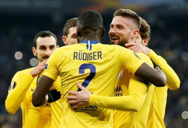 Chelsea's Olivier Giroud celebrates scoring their fourth goal to complete his hat-trick with Antonio Rudiger and team mates.