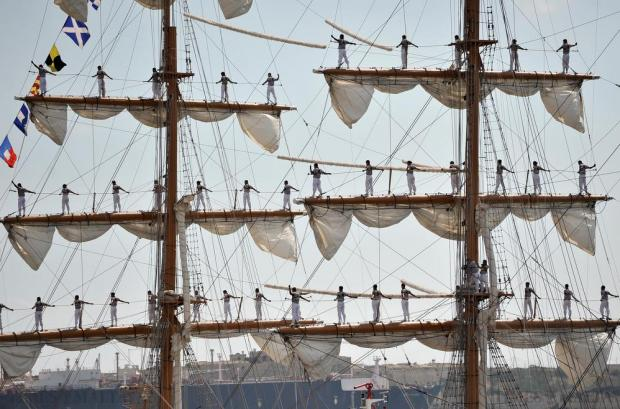 The Mexican Navy training ship Cuauhtémoc sails into Grand Harbour with some of its crew perched on the high booms on August 21. Photo: Chris Sant Fournier