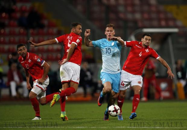Malta's Andrei Agius and Gareth Sciberras fight for the ball with Slovenia's Valter Birsa during their 2018 World Cup qualifying match at the National Stadium in Ta'Qali on November 11. Photo: Darrin Zammit Lupi