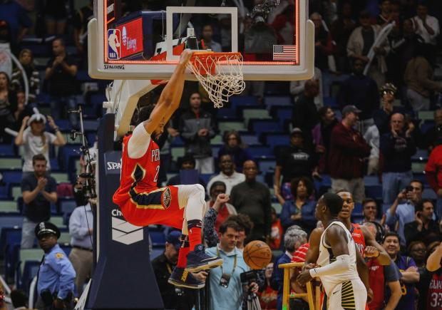 New Orleans Pelicans forward Anthony Davis (23) dunks on the opposite end of the court following the end of the game to celebrate a win against the New Orleans Pelicans at the Smoothie King Center. The Pelicans defeated the Pacers 96-92. Photo Credit: Derick E. Hingle-USA TODAY Sports