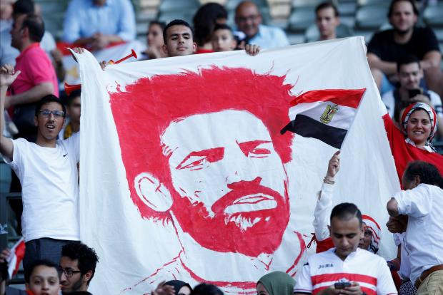 Egypt fans with a banner of Mohamed Salah before the match.