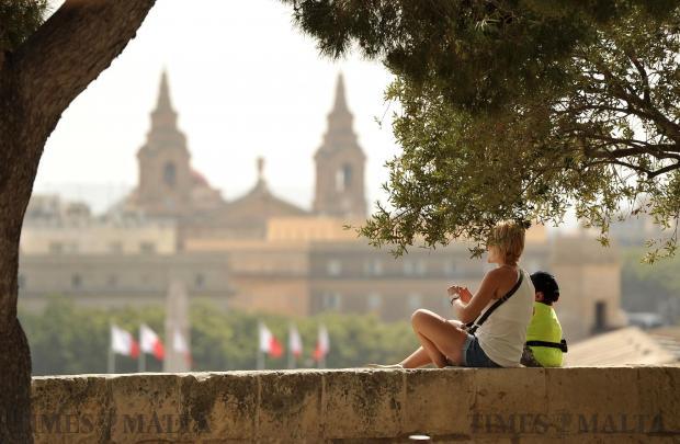 Tourists sit on the Barrakka bastion in Valletta on April 26. Photo: Chris Sant Fournier