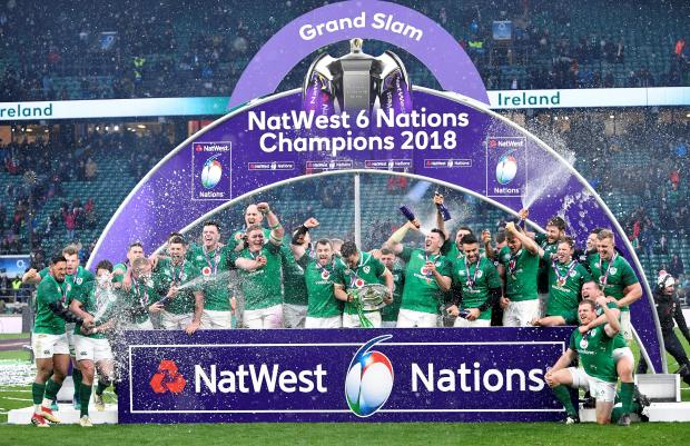 Ireland's Johnny Sexton celebrates with the Triple Crown trophy and team mates during the presentation at the end of the match.