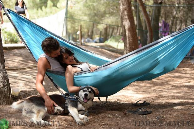 A couple lay on a hammock with a dog beside them during the Earth Garden festival in Ta' Qali on June 3. Photo: Mark Zammit Cordina