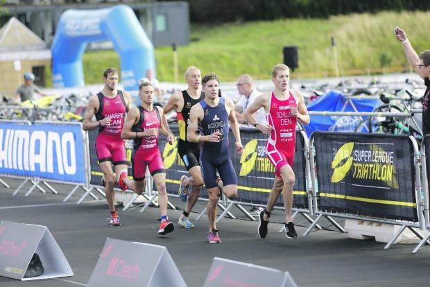 Triathletes complete in the Super League Triathlon qualifying event held in Poznan, Poland, earlier this month.