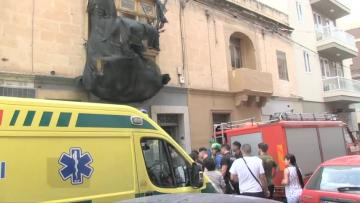 Rescuers take elderly woman out of building after roof caves in