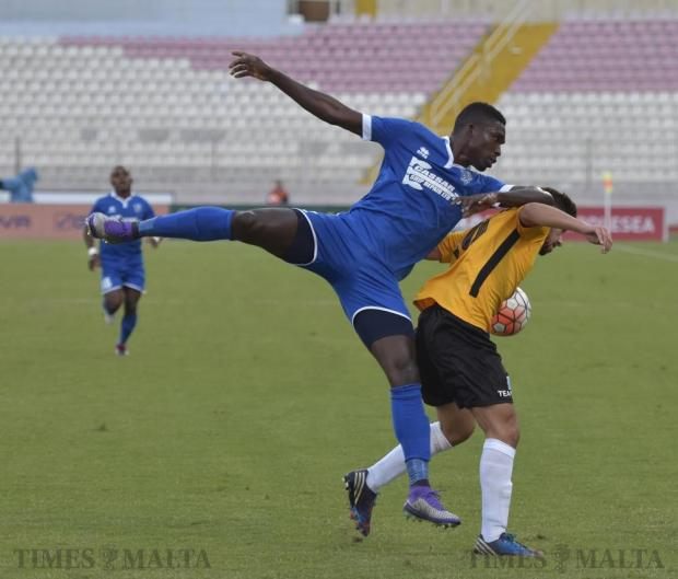 Tarxien Rainbows' Ebiabowei Baker jumps on Sliema Wanderers' Jean Paul Farrugia during their Premier League football match at the National Stadium in Ta' Qali on September 25. Photo: Mark Zammit Cordina