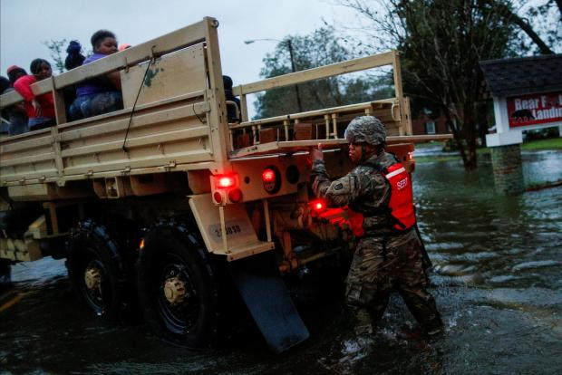 In some places, the US Army was brought in to rescue people. Photo: Reuters