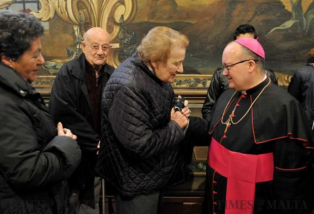 Archbishop Joseph Scicluna exchanges new years greetings with the public on December 30. Photo: Chris Sant Fournier