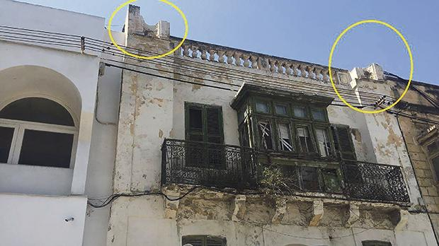 Two historic statues are missing from the facade of a building proposed for demolition.