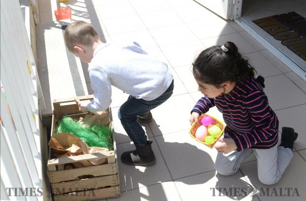 Children search for Easter eggs during an Easter egg hunt at Soho Sweet Shop in Attard on April 15. Photo: Matthew Mirabelli