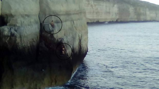 The two men (circled) before they were rescued.