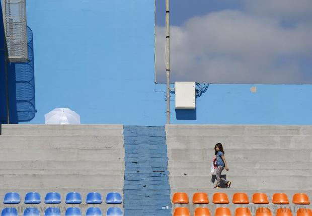 A young girl walks along the spectators' terrace during the 2015 Easter International Swim Meet at the National Pool in Tal-Qroqq on April 11. Photo: Darrin Zammit Lupi