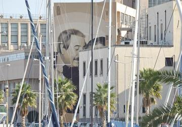A large mural of Giovanni Falcone and Paolo Borsellino.