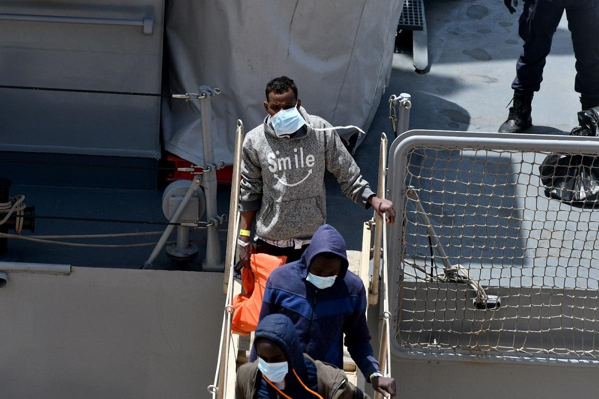 One of the migrants disembarking in Malta on Tuesday. Photo: Jonathan Borg