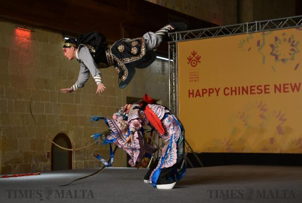 A man jumps over another man in costume from China's Zhejiang Wu Opera Troupe on stage during the Chinese new year celebrations held in Valletta on February 14. Photo: Mark Zammit Cordina