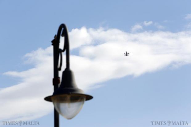 A plane climbs over Ta' Qali on December 29. Photo: Darrin Zammit Lupi