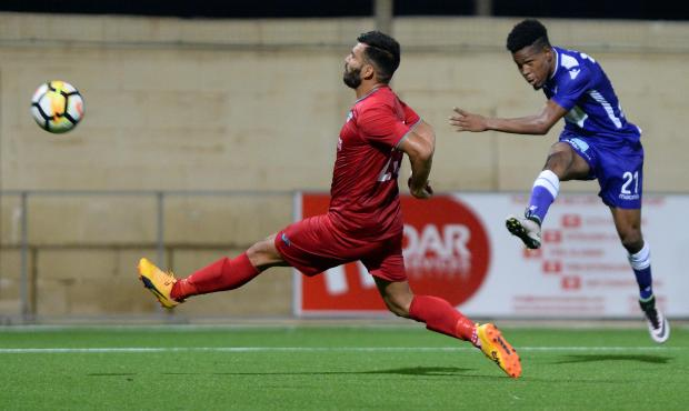 Degran Jackson (no.21) of St Andrews attempts a shot on goal against Balzan during their BOV Premier League match at Centenary Stadium in Ta' Qali on August 25. Photo: Matthew Mirabelli