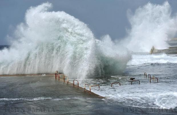 Waves crash against the quay in Cirkewwa on April 8. Photo: Chris Sant Fournier