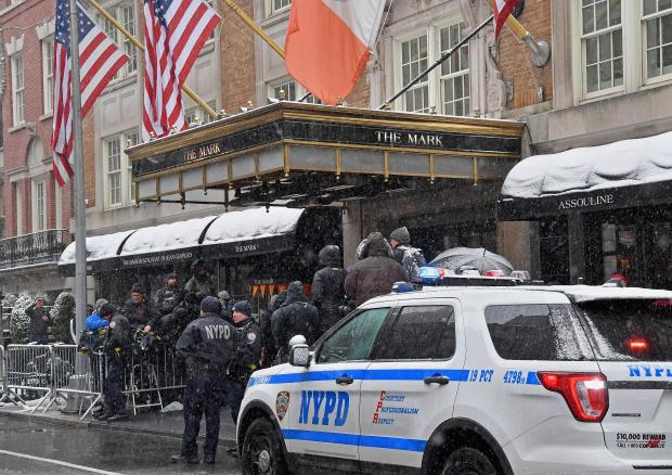 New York police officers and members of the press stand outside The Mark Hotel during Meghan, Duchess of Sussex's baby shower on February 20, 2019 in New York City.