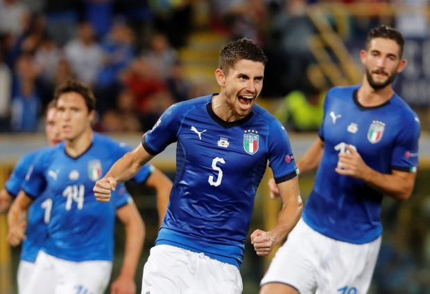 Italy's Jorginho celebrates scoring their first goal with team mates.