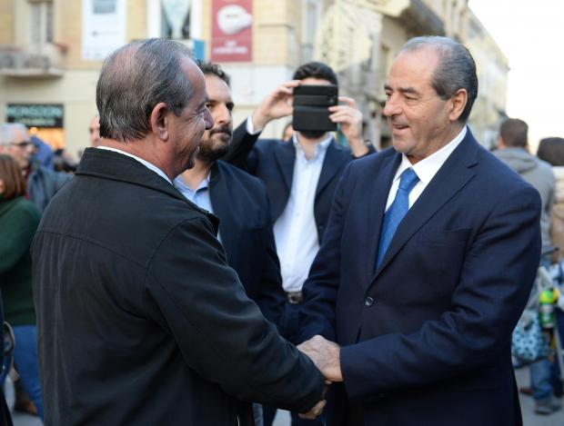 Italian Judge Antonio Di Pietro is greeted by former Prime Minister Lawrence Gonzi at a demonstration organized by the Civil Society Network in Valletta on December 3. Photo: Matthew Mirabelli