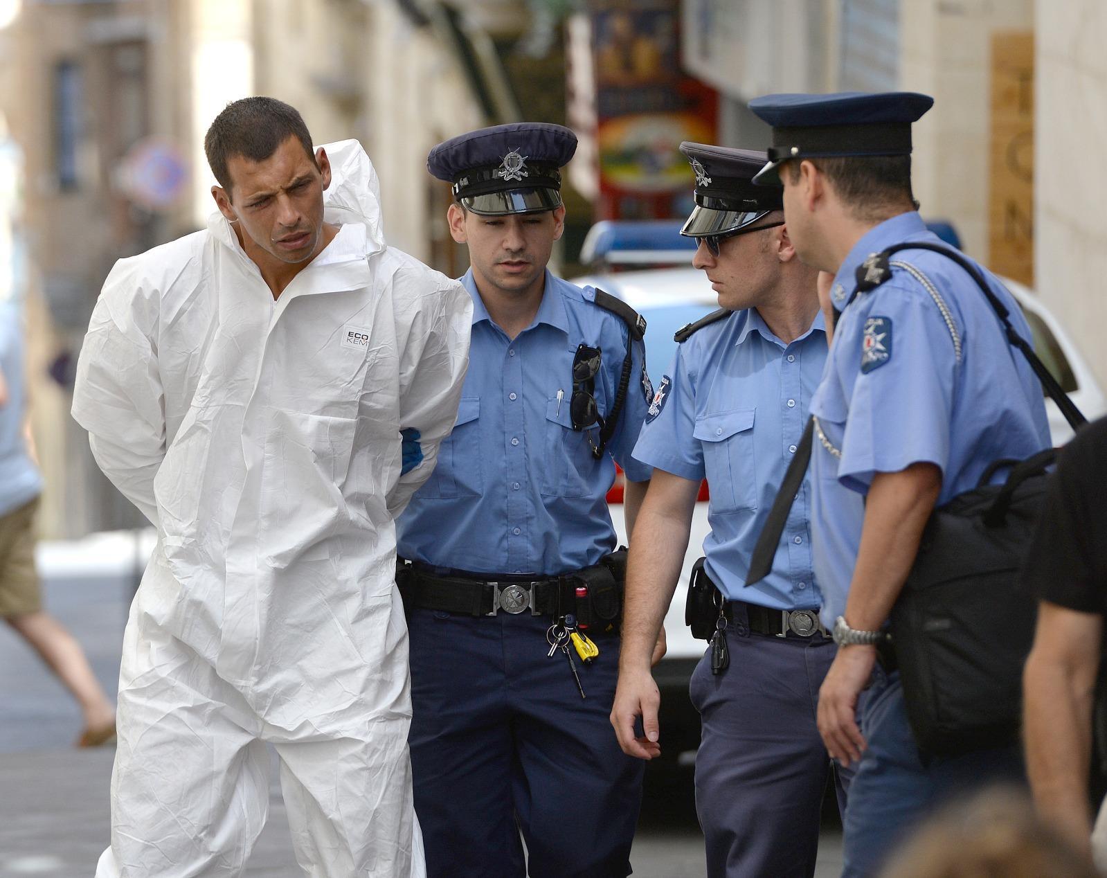 Bojan Cmelik is escorted to court for his arraignment. Photo: Matthew Mirabelli