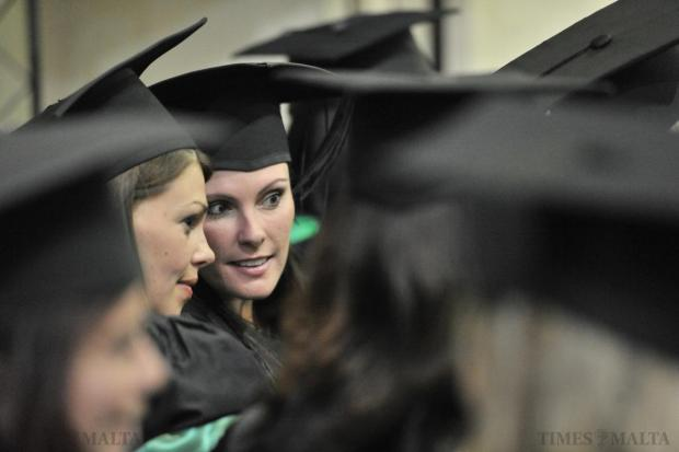 New graduates share a thought during their graduation ceremony on November 19. Photo: Jason Borg