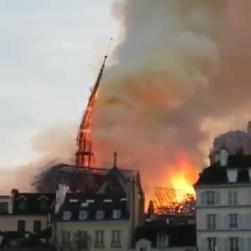 The moment the spire came crashing down.