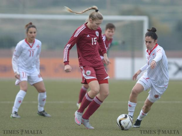 Malta's Ylenia Carabott (right) beats Latvia's Karlina Miksone (centre) during soccer friendly at the Centenary Stadium in Ta'Qali on January 19. Carabott scored twice and Martina Borg added another goal as the Maltese women's national team won the match 3-0. Photo: Matthew Mirabelli