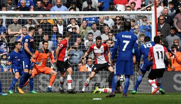 Chelsea's Olivier Giroud scores their third goal.
