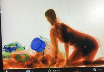 Woman follows handbag into X-ray machine